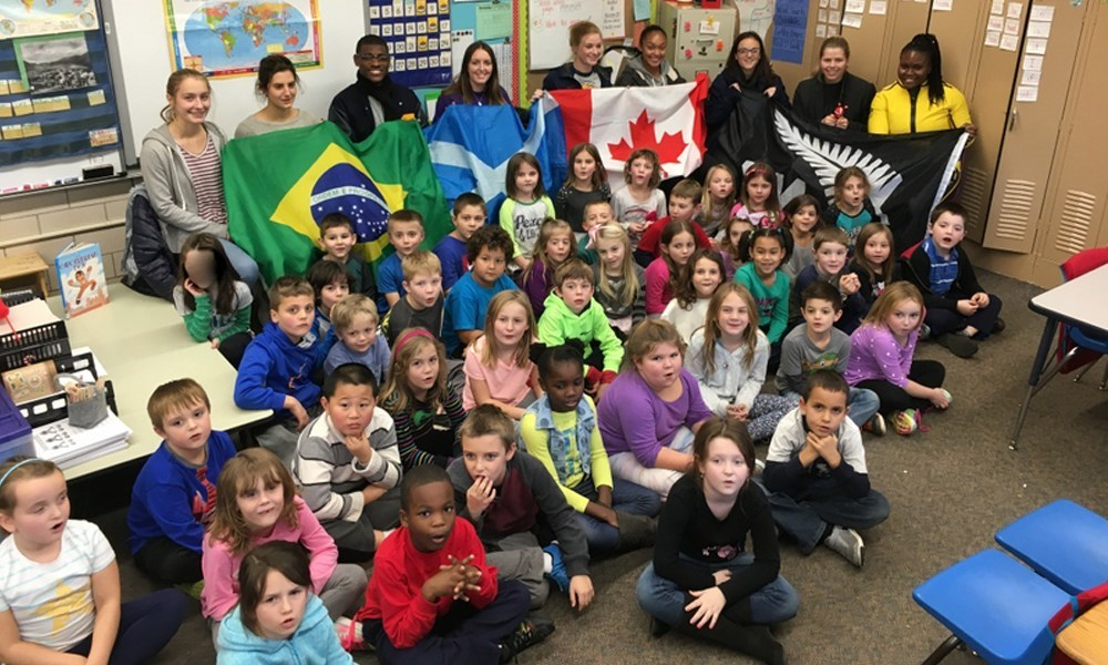 International Student-Athletes Team Up With Woodland Elementary